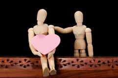 Houten modellen in een romantische stemming Stock Fotografie