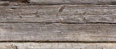 Houten muur van het oude logboekhuis stock afbeeldingen