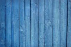 Houten Palissadeachtergrond, blauwe verf Royalty-vrije Stock Foto's