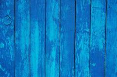 Houten Palissadeachtergrond, blauwe verf Stock Foto