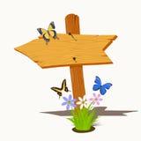 Houten pijl met bloemen en vlinders royalty-vrije illustratie
