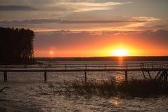 Houten pijler bij zonsondergang Stock Fotografie