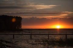 Houten pijler bij zonsondergang Stock Foto