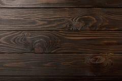 Houten planken een donkere bruine kleurenachtergrond Stock Foto
