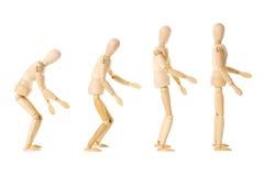 Houten poppen met verschillende houdingen stock afbeelding