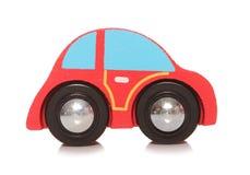 Houten rode stuk speelgoed auto Royalty-vrije Stock Afbeeldingen