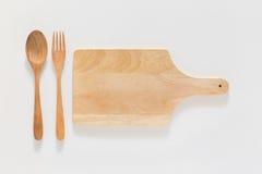 Houten scherpe raad en vork Stock Afbeeldingen