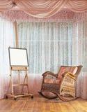 Houten schildersezel en rieten schommelstoelsamenstelling Stock Afbeeldingen