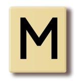 Houten speltegel met de brief M Stock Afbeeldingen