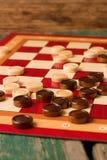 Houten stenen aan boord voor Spel van Controleurs Royalty-vrije Stock Afbeelding