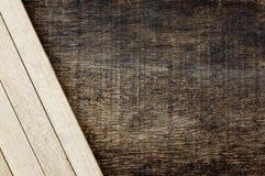 Houten stokken op de houten achtergrond Royalty-vrije Stock Fotografie