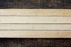 Houten stokken op oude houten achtergrond Stock Foto