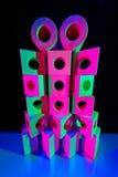 Houten stuk speelgoed blokken in gekleurd licht Royalty-vrije Stock Foto