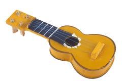 Houten stuk speelgoed gitaar Royalty-vrije Stock Afbeeldingen