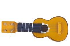 Houten stuk speelgoed gitaar Royalty-vrije Stock Foto