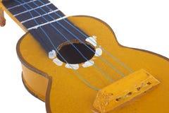 Houten stuk speelgoed gitaar Stock Foto