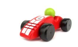 Houten stuk speelgoed raceauto stock foto's