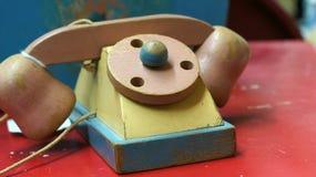 Houten stuk speelgoed telefoon royalty-vrije stock foto's