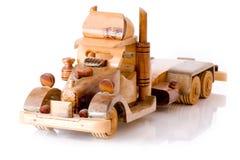 Houten stuk speelgoed vrachtwagen Stock Afbeeldingen