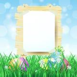 Houten teken en paaseieren op de lenteachtergrond Royalty-vrije Stock Foto's