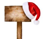 Houten teken met de hoed van de Kerstman Stock Foto
