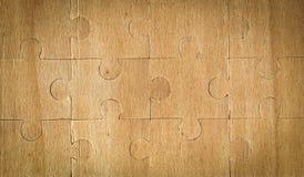 Houten textuur die in het raadsel wordt verzameld stock foto's