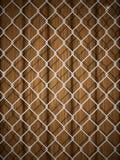 Houten textuur met kettingsomheining. Royalty-vrije Stock Foto