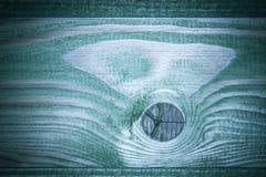 Houten textuur met knopen raad omvat met groene impregnatie Stock Fotografie