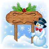 Houten uithangbord met Sneeuwman Royalty-vrije Stock Afbeelding