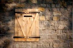 Houten venster en steenmuur royalty-vrije stock foto