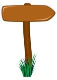 Houten verkeersteken als pijl in gras Stock Afbeelding
