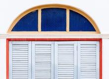 Houten vouwende deuren met het kader van het kleurenglas Stock Afbeeldingen