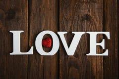 houten woordliefde Stock Afbeeldingen