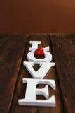 houten woordliefde Stock Afbeelding