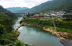 Houtong Cat Village and the old coal bridge over the Keelung River in Ruifang District, Taiwan Stock Photos
