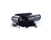 Houtskoolcapsules royalty-vrije stock afbeelding