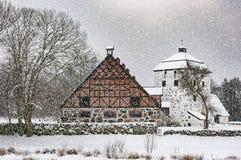 Hovdala-Schloss-Gatehouse und Ställe im Winter Stockbilder
