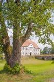 Hovdala Slott behind tree Royalty Free Stock Photos
