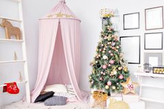 Hovel prepared for children. Beautiful New Year decor of the children room Christmas house. Royalty Free Stock Photo