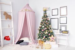 Hovel prepared for children. Beautiful New Year decor of the children room Christmas house. royalty free stock images