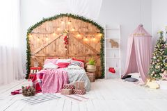 Hovel prepared for children. Beautiful New Year decor of the children room Christmas house. Stock Image