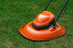 Hover Lawn Mower. Garden hover lawn mower on grass stock images