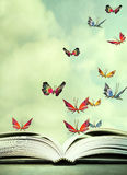 Hover in the Sky. Artistic image of an open book and colorful butterflies that hover in the sky stock illustration