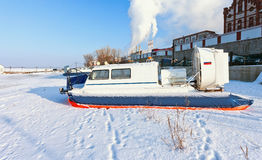 Hovercraft at the bank of a frozen river Royalty Free Stock Photo