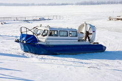 Hovercraft crossing frozen river Royalty Free Stock Images