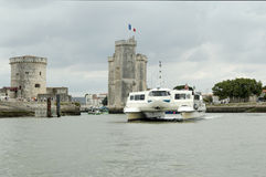 Hovercraft cruise. La Rochelle Harbour (France) Saint Nicolas and La Chaine towers Royalty Free Stock Images