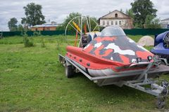 The hovercraft is in the machine trailer.  Royalty Free Stock Photos