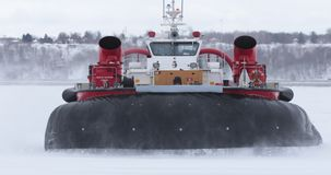 Hovercraft operating on ice. Large view of hovercraft operating on ice in winter condition stock footage