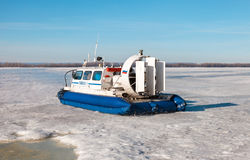 Hovercraft with passengers on the ice of the frozen Volga river Royalty Free Stock Photos