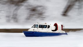 The hovercraft speeding along the river Stock Photo